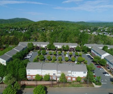 Ample parking for you and your guests at Woodlands of Charlottesville rental apartments