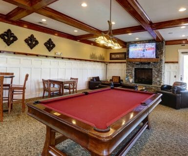 Pool table at the luxury apartments for lease: Woodlands of Charlottesville