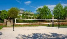 Full-size volleyball court at Woodlands of Charlottesville luxury apartments