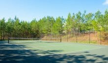 Tennis court at Woodlands of Charlottesville luxury apartment rentals